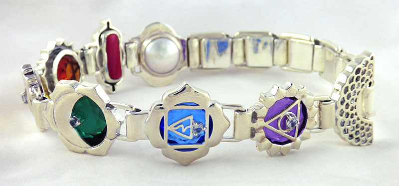 crystal healing jewelry made with quartz crystals and chakra design