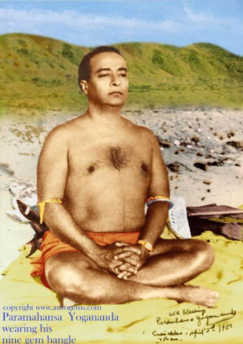 Paramahansa Yogananda meditating on the beach wearing nine gem bangles